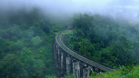 Foggy morning in mountain countryside with Nine Arches Bridge. Sri Lamka Footage