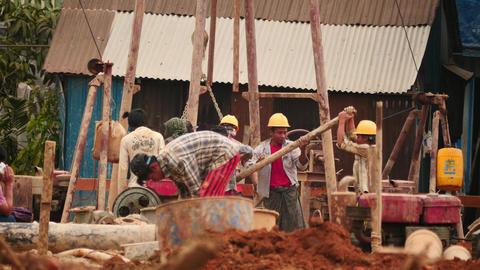 Builders at work in Yangon - Myanmar house building 2 Footage