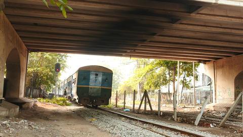 Train departure and motion under bridge - Yangon in Myanmar Live Action