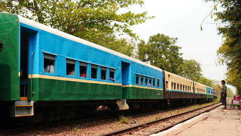Train departure from small station of Yangon circular road in Myanmar Live Action