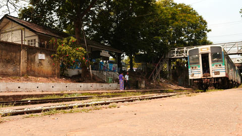train arrival dolly shot of small Yangon station in Myanmar Live Action