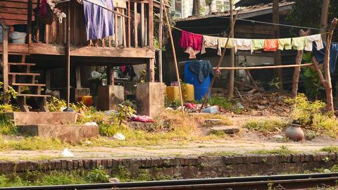 Houses near railway in Yangon Myanmar - closeup dolly shot Footage