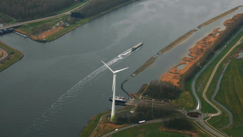 Netherlands aerial panoram view on river ship ferry wind turbine power plant eco Footage