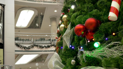 4K Big Decorated Christmas Tree in Shopping Center Flickers With Festive Footage
