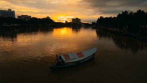 Sarawak River dyed in sunset, Dolly shot with boat Footage