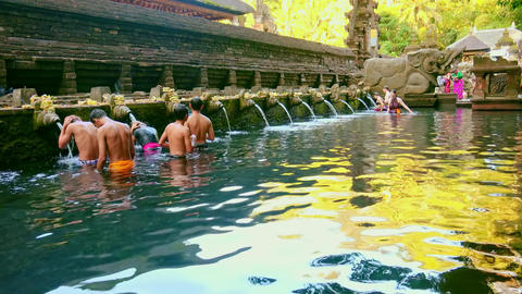 Holy spring water and sacred pool. Pura Tirta Empul Temple. Bali, Indonesia Footage