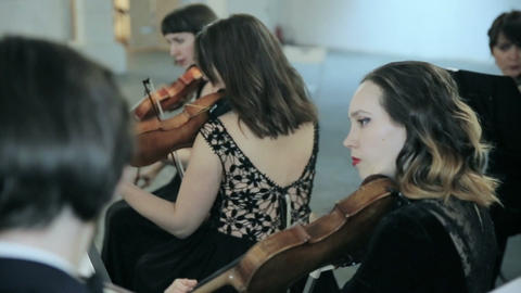 Close-up of musician playing violin on the symphony hall Footage