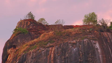 Sunset view Lion Rock fortress with ancient gardens world heritage in Sri Lanka Live Action