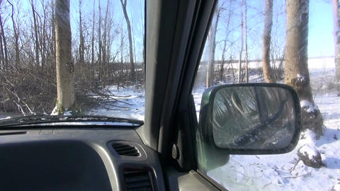 Jeep in winter forest byroad roadless Live Action