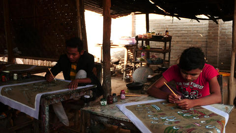 Young painter making picture on paper - Myanmar Footage