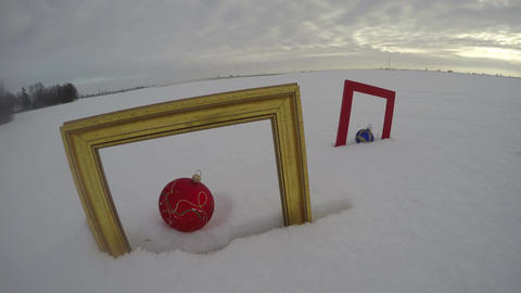 Field with Christmas baubles in frames, time lapse 4K Footage