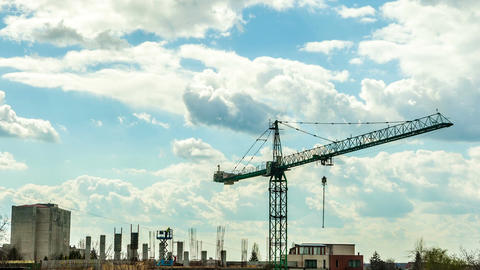 Beautiful time lapse of crane on industrial construction yard