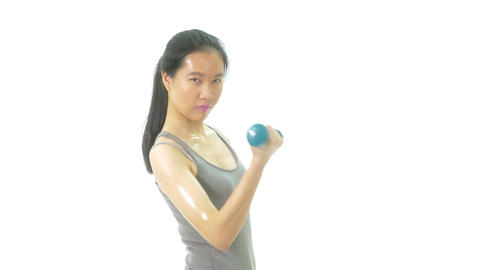 Asian teenage girl curling dumbbell looking at camera 1 Footage