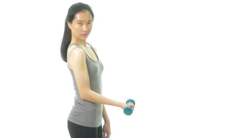 Asian teenage girl curling dumbbell serious 1