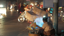 Woman selling corn on busy road,Mandalay,Burma Footage
