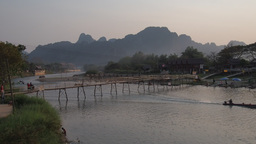 Bamboo bridge with boat passing,Vang Vieng,Laos Footage