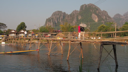 Bamboo bridge with tourists passing,Vang Vieng,Laos Footage