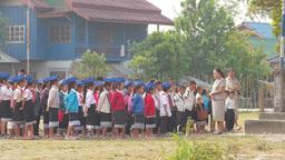 School kids get instructed before start of school,Vang Vieng,Laos Footage
