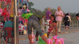 A Girl Gets A Toy At Mekong River Shore,Vientiane,Laos stock footage