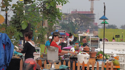 Cooking on the street restaurant at the Mekong,Vientiane,Laos Footage
