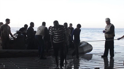 Navy Ships rescue people from Sinking Vessel in Mediterranean Sea Footage
