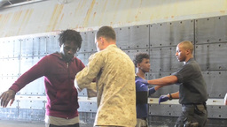 Navy Ships rescue people from Sinking Vessel in... Stock Video Footage