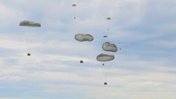 Parachuting out of a C-130 Hercules transport aircraft Stock Video Footage
