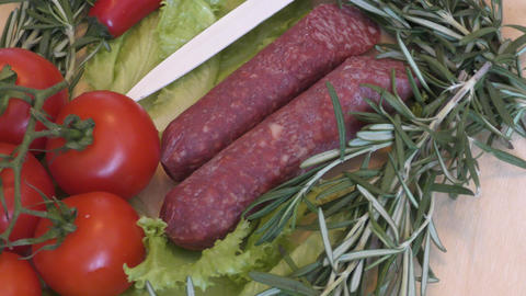 Slice sausage and fresh herbs Stock Video Footage