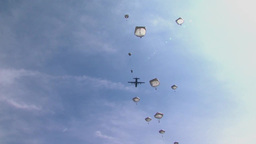 Paratroopers jumping from Hercules parachute Footage