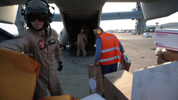 Airmen load mail onto a MV-22 osprey for a USS Bataan... Stock Video Footage