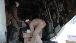 Airmen load mail onto a MV-22 osprey for a USS Bataan Delivery Footage