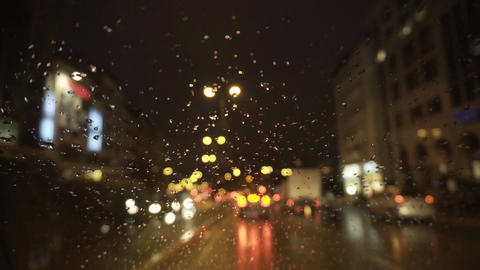 raindrops on a car windscreen at night - 4k Live Action