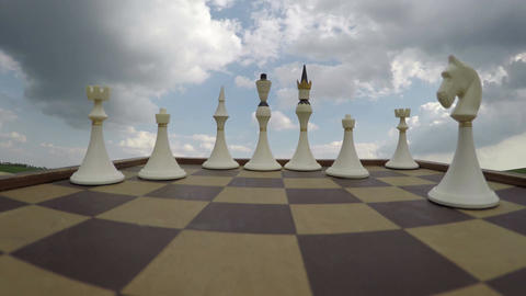 Chess pieces under cloudy sky, time lapse 4K Footage