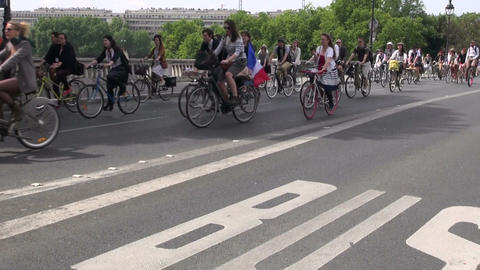bicyclist action in Paris street on bridge. MAY 25, 2014 in Paris, France Live Action