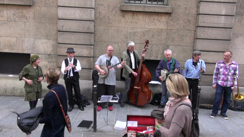 group street musicians seniors play before public in Paris Footage