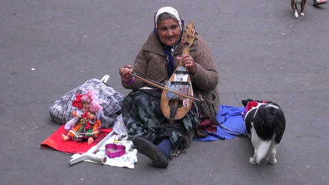 old woman musician emigrant playing on ancient violin in Paris street, MAY 25, 2 Footage