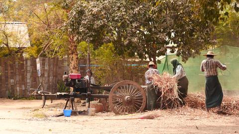 Crops processing on motor device in village - Myanmar Footage