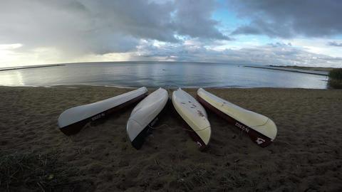 4 upturned kayaks on shore, 4K Footage