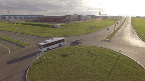 Bus Cars Drive along Round Junction among Green Fields Footage