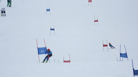 Skiers goes down on downhill Footage