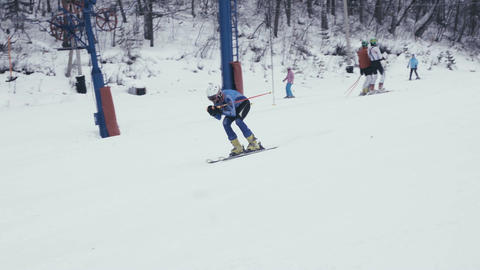 Skier is going down on downhill Footage