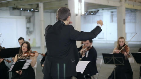 Orchestra conductor symphony play instrument Footage