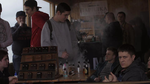 People stay in specialized shop of electronic cigarettes. Fair. Vapers. Steam Footage