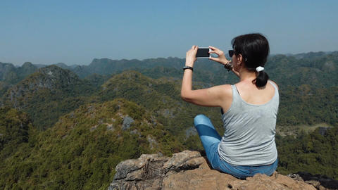 Woman taking pictures of beautiful views of Cat Ba Island Footage