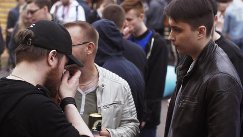 Young people smoke electronic cigarettes on street fair. Vapers festival. Steam Footage