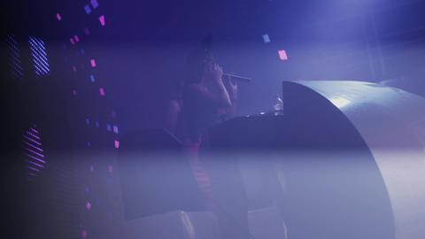 Dj girl and Mc girl perform at turntable in nightclub. Artists. Illuminations Footage