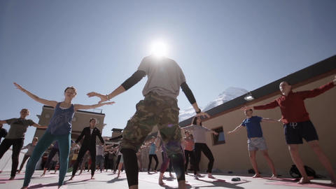 People do yoga at outdoor playground in sunny morning, hands down. Fresh air. Mo Footage