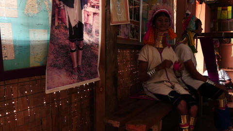 Paduang tribe of Myanmar long neck women on a bench 2 Footage
