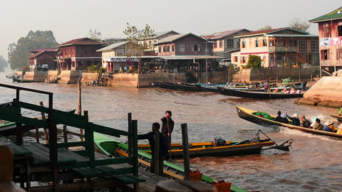 Jetty in Nyaungshwe at Inle lake with boats slow motion - Myanmar Footage