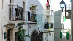 Europe Spain Balearic Ibiza Eivissa city 159 laundry on balcony railings Footage